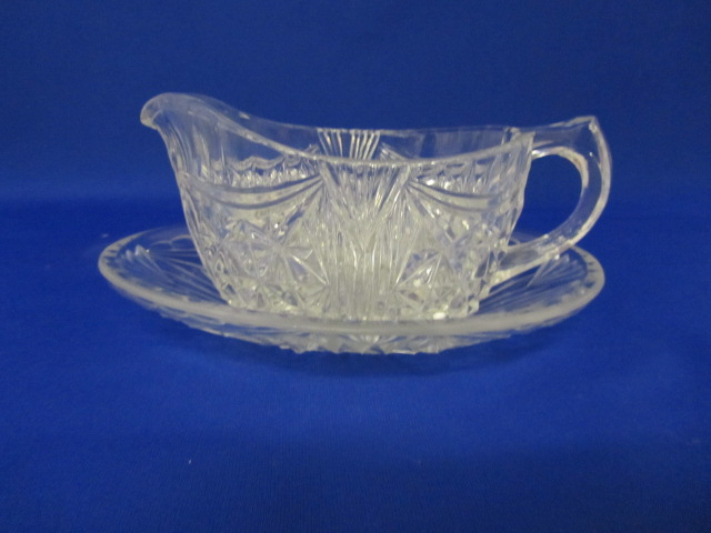 Highly collectable Depression glass gravy boat and tray