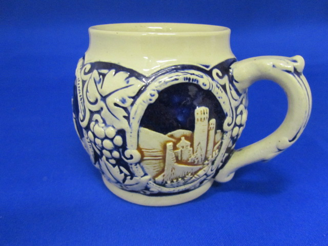 Highly collectable white and cobalt Beer stein